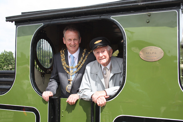 Bryan Thistlethwaite (Mayor of Darlington) in the capable hands of retired Darlington driver Alan Gill