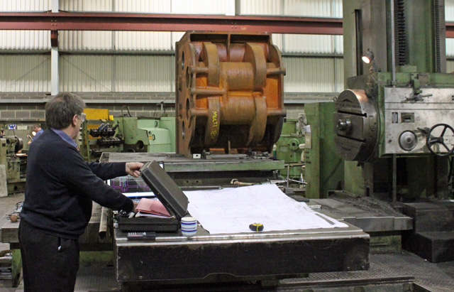 David Elliot, the NELPG representative, with the cylinder block on the planing machine bed.