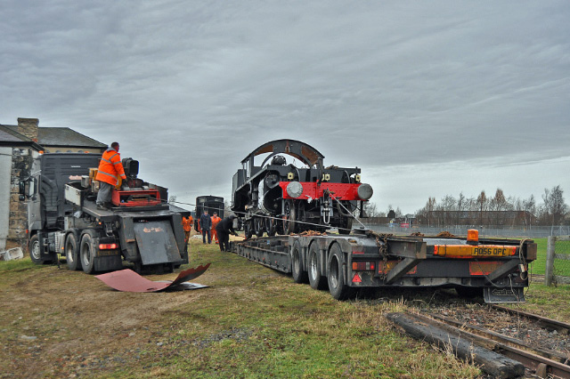 The K1 frames are hauled up the ramp and onto the low loader trailer - Colin Smith