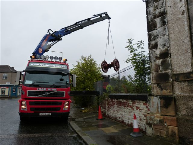 The hiab reaches over the fence with the centre wheelset - Terry Newman