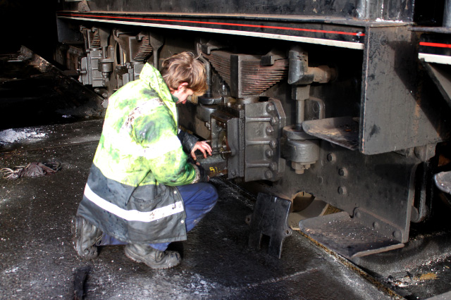 Rob Williams checks lubrication of the tender underkeeps - Neal Woods