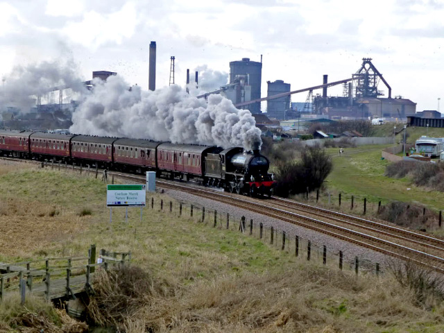 The K1 approaching Redcar at Coatham Marshes with the SSI Steel Works in the background - Steve Hyman