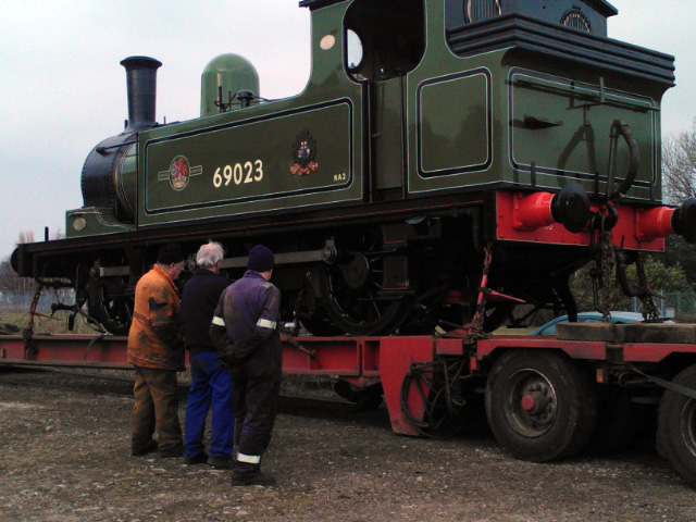 Malky Simpson, Fred Ramshaw and Steve Gibson check the loco is secure on the low loader - John Hall