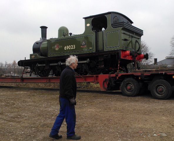 "A ""proprietorial"" Fred looks anxiously on as the low loader begins its manoeuvring prior to setting off for Leeming at about 7 p.m. - John Hall"