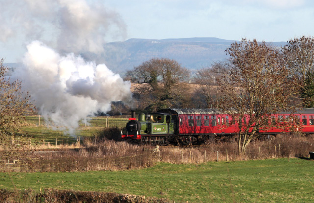 With the Cleveland Hills as a backdrop Joem climbs from Bedale towards Newton le Willows on the 12.30 Santa Special - Maurice Burns