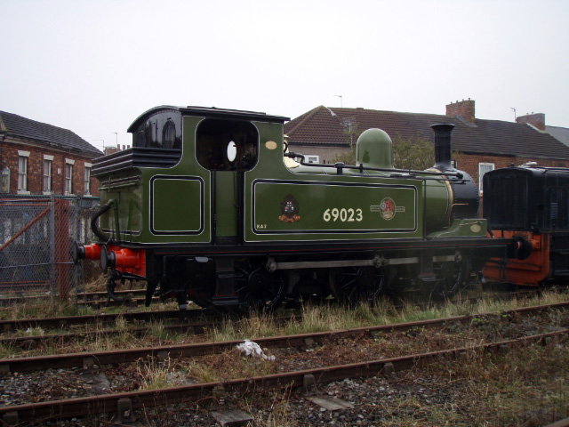 The J72 sees first the light of day for 3 months as it is is towed out of the shed - Nigel Hall