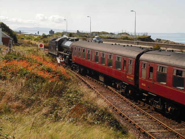 After drawing the coaches up the bank, 62005 pushes The Jacobite into platform 2 - John Midcalf