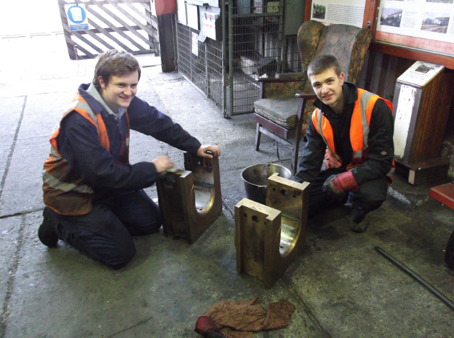 The Q6 axle boxes in Deviation Shed being cleaned by NYMR cleaners Stephen Thornton and James Purdy - Darrin Crone