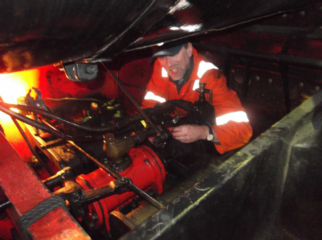 Andy Lowes repacking glands on the steam reverser - Darrin Crone