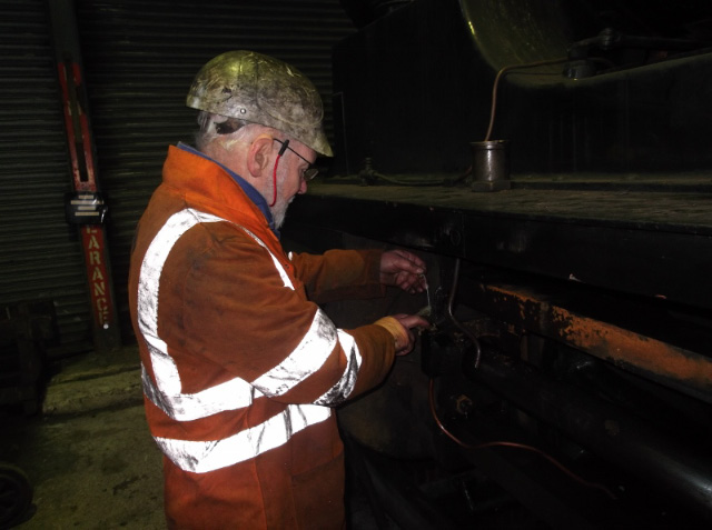 Terry Newman inspecting lubricator trimmings - Darrin Crone