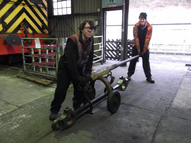 Our James Pearcy helped by NYMR cleaner Chris Wakefield moving Q6 rods from NYMR shed where the last side rod bush has just been pressed out - Darrin Crone
