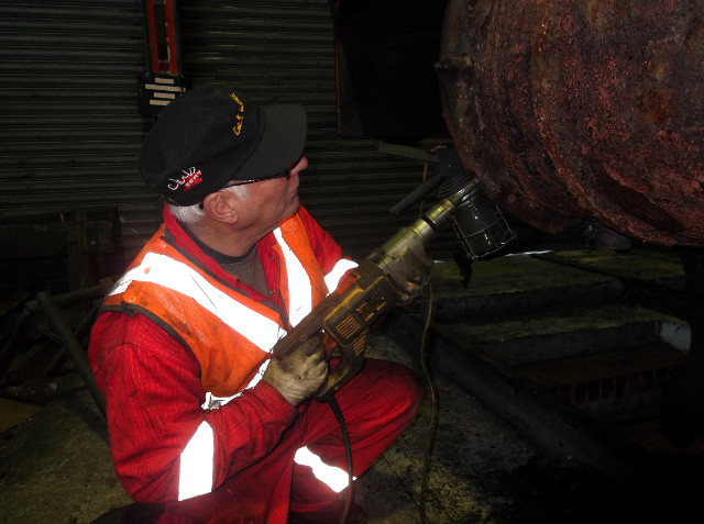 Ian Pearson drilling out a broken cylinder cladding screw - Darrin Crone