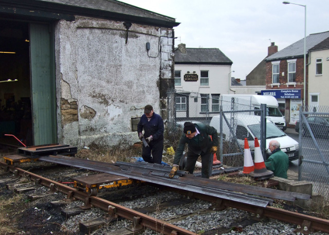 Derek Shorton and Dave Wright  load a delivery of steel angle to repair the rotting tender frames onto the rail trolleys - Colin Smith
