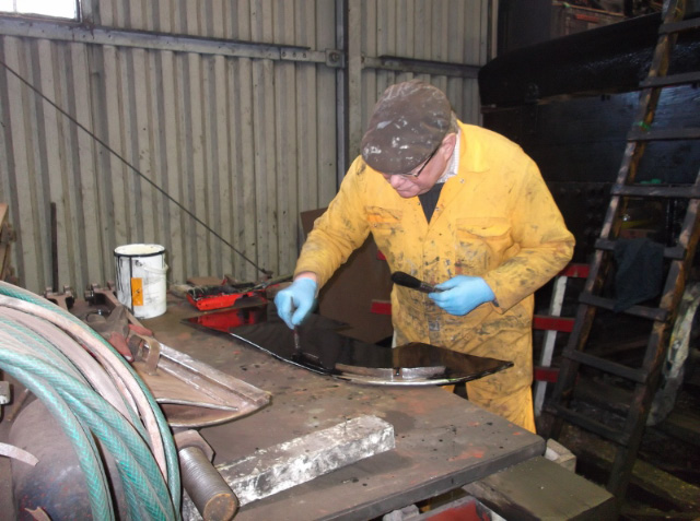 Nigel Hall applying primer coat to the firehole heat shield. Wed 25/3/15 Darrin Crone