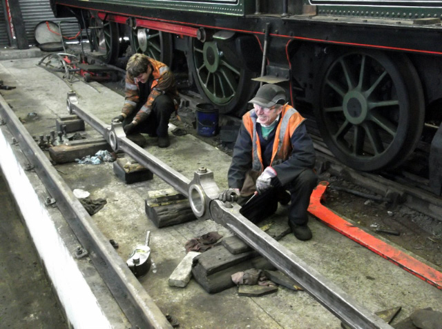 James Pearcy fitted a new cotter replacing a cracked old cotter to the right hand side rods. Les Harper next to 3444's cotter. The rods show the benefit of Derek Shorten's cleaning. 11/4/15 - Darrin Crone