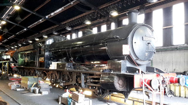 After weighing, the weigjing gear being boxed up again. The concrete bags on the running board are to add the weight of the arch which has still to be constructed - Nigel Hall