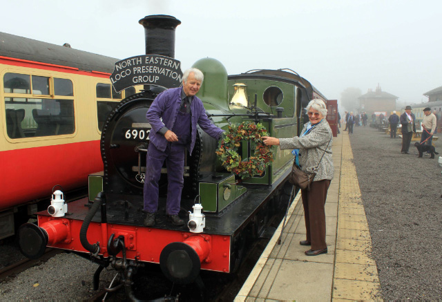 Margaret Stevenson hands the commemorative wreath to driver Fred Ramshaw at Leeming Bar Station prior to departure - David Pennock