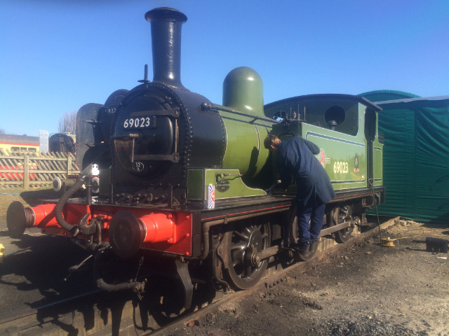 Good Friday, and fireman James Piercy uses the brasso to polish up the J72 at the start of the day - Fred Ramshaw