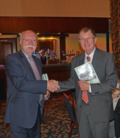 President Andrew Scott presents guest Dr Ian Pearce with a copy of the 50th Anniversary book  - John Hunt
