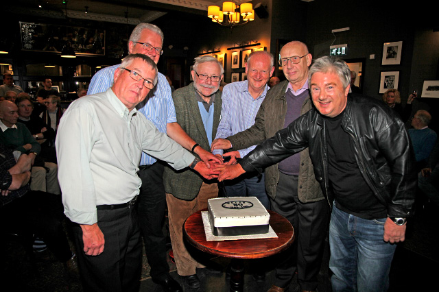 First meeting attendees: Dave Johnson,Mick Denholm ,Chris Smyth, Richard Wheeler,  John Shaw and Bob Anderson cut the cake  - Maurice Burns