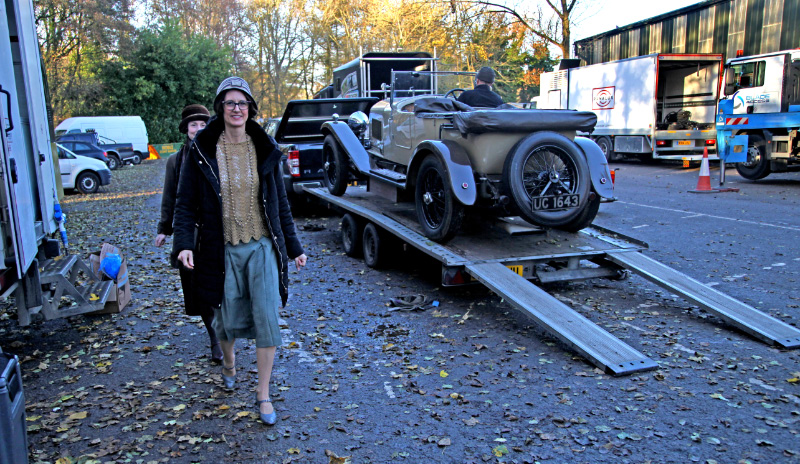 In Pickering station car park a Bentley is about to be unloaded as actors walk by - Maurice Burns