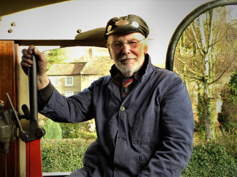 One of the NYMR's longest serving and Top Link driver Terry Newman who needed no make up for the film, poses in the cab of the J27  - Maurice Burns