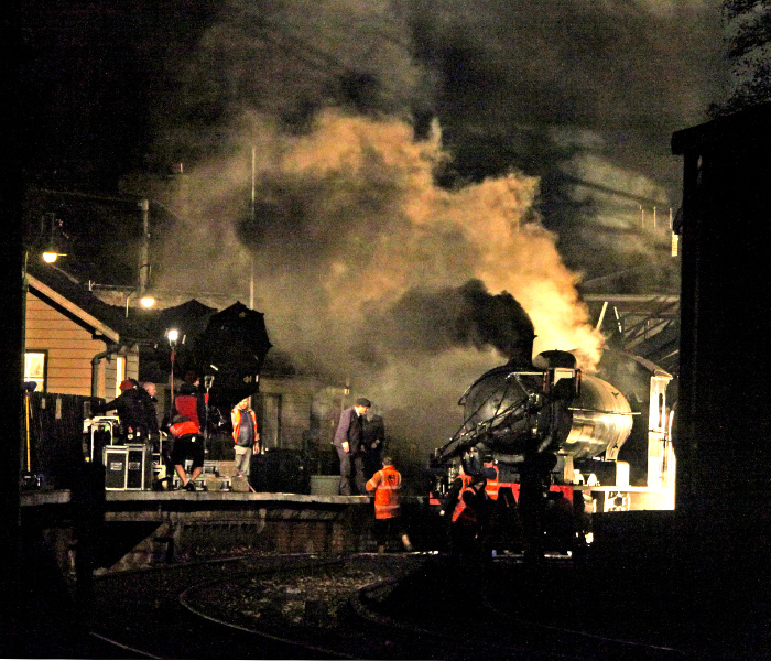 A picture that sums up the atmosphere of the filming after dark. Q6 driver Neil Woods (on the platform) receives instructions from the producer on the track whilst fireman Phil Acaster prepares the fire  prior to the dramatic departure - Maurice Burns
