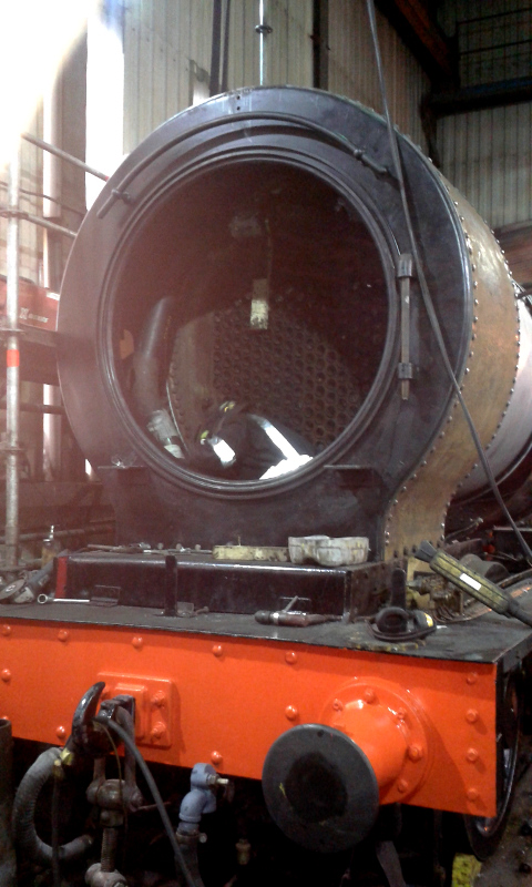 A view of the state of the smokebox showing the completed wrapper plate and Phil Naylor working on the main steam pipe - Chris Lawson