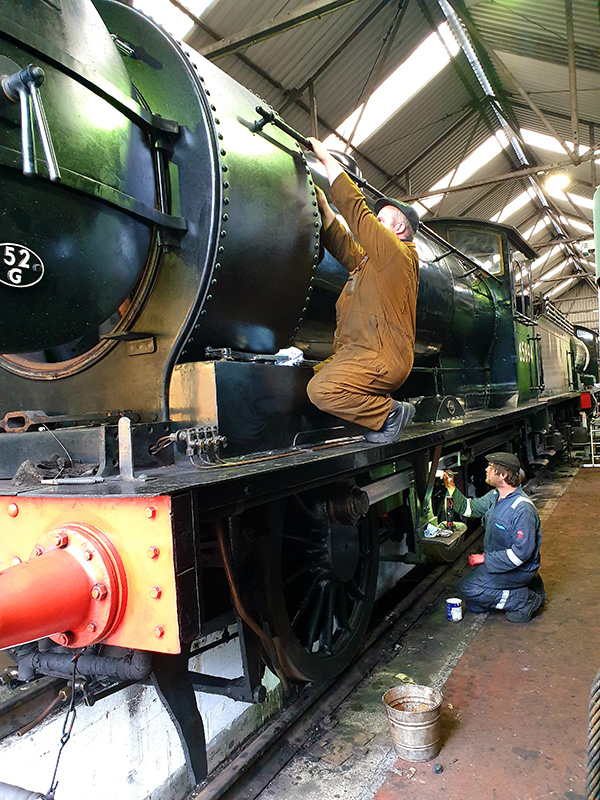 65894 being cleaned in Deviation Shed by Robson Hewitson and Andrew Jeffrey on 2 July 2020 - Chris Henwood.