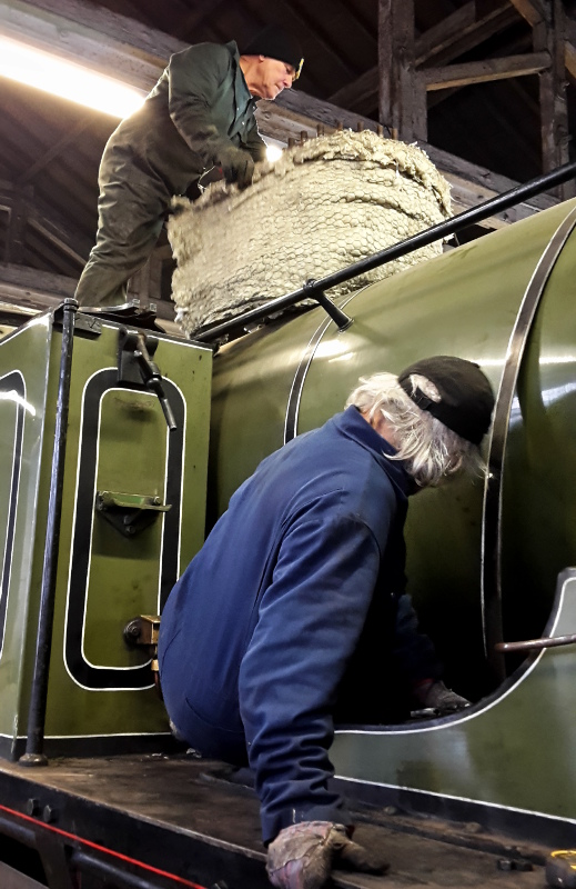 Tim Williamson releases the boiler bands whilst Dave Wright above removes the insulation from the dome - Nigel Hall