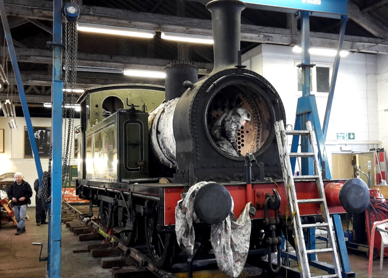 Arthur  Jenkins breaking concrete within the smokebox. The front sandboxes and most of the cladding have been removed - Nigel Hall