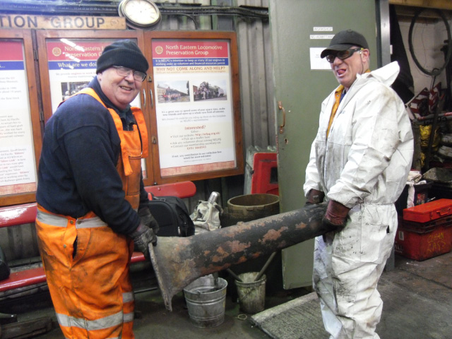Out it comes, Nigel Bill and Ian Pearson with the blast pipe - Andy Lowes