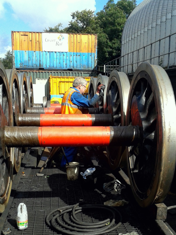 Nigel Hall cleaning the tyres and Gibson rings for painting - Chris Lawson