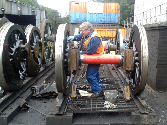A man happy in his work - Nigel Hall at Grosmont applying first gloss to the Q6 wheelsets - Chris Lawson
